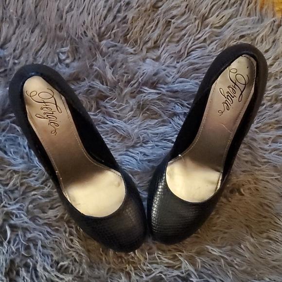Women's high heel gently worn shoes.